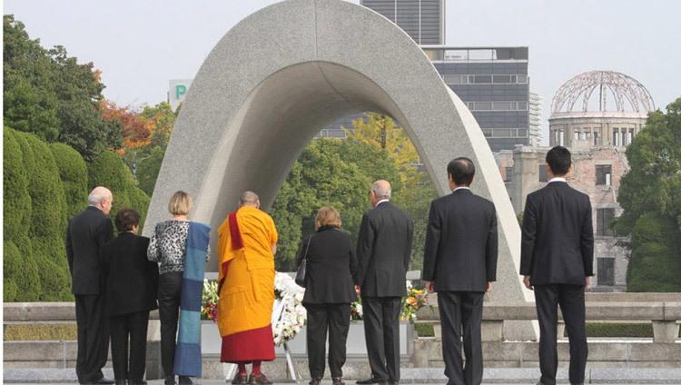 His Holiness the Dalai Lama and fellow Nobel Laureates paying their respects at Hiroshima Memorial Park in Hiroshima, Japan on November 14, 2010. Photo by Taikan Usui