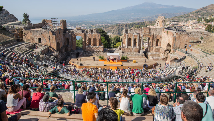 "A view of the Greek Theatre with over 2,500 people attending the talk by His Holiness the Dalai Lama on ""Peace is the Meeting of Peoples"" in Taormina, Sicily, Italy on September 16, 2017. Photo by Paolo Regis"