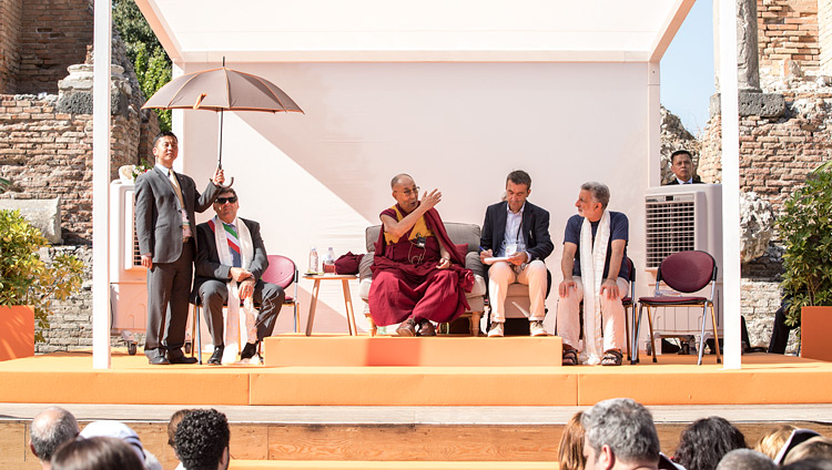"His Holiness the Dalai Lama speaking on ""Peace is the Meeting of Peoples"" at the Greek Theatre in Taormina, Sicily, Italy on September 16, 2017. Photo by Paolo Regis"