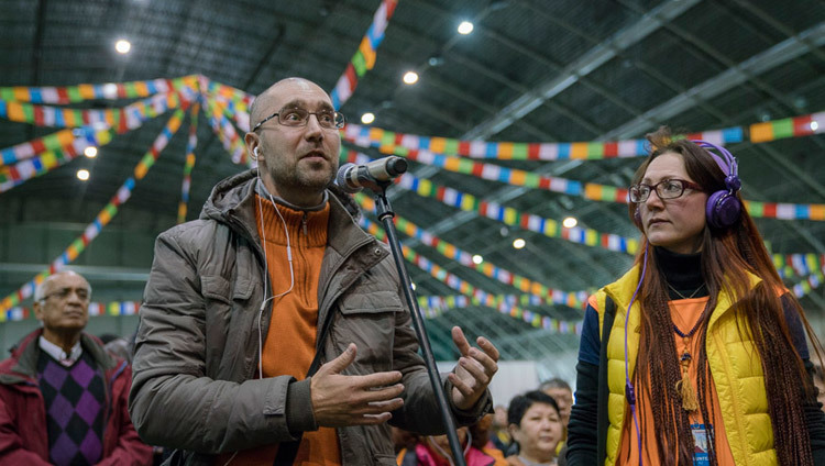 A member of the audience asking His Holiness the Dalai Lama a teaching during the teaching in Riga, Latvia on October 10, 2016. Photo/Tenzin Choejor