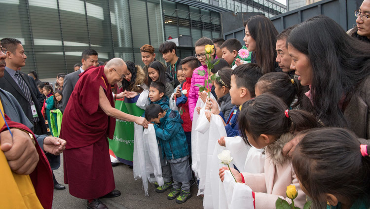 His Holiness the Dalai Lama being welcomed by children as he arrives at the Hallenstadion in Zurich, Switzerland on October 14, 2016. Photo/Manuel Bauer