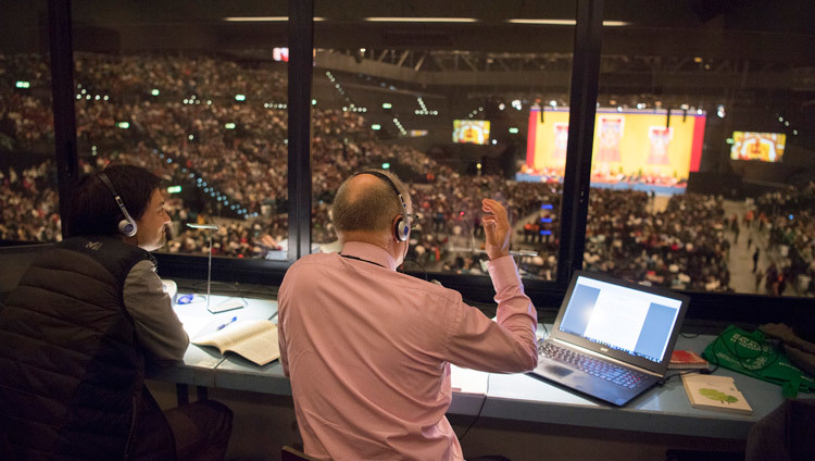 One of several interpreters at His Holiness the Dalai Lama's teaching at the Hallenstadion in Zurich, Switzerland on October 14, 2016. Photo/Manuel Bauer