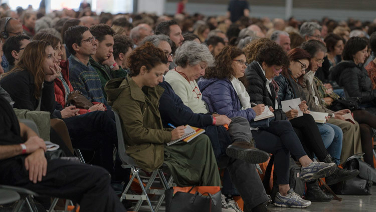 Members of the audience taking notes during His Holiness the Dalai Lama's teaching in Milan, Italy on October 21, 2016. Photo/Tenzin Choejor/OHHDL