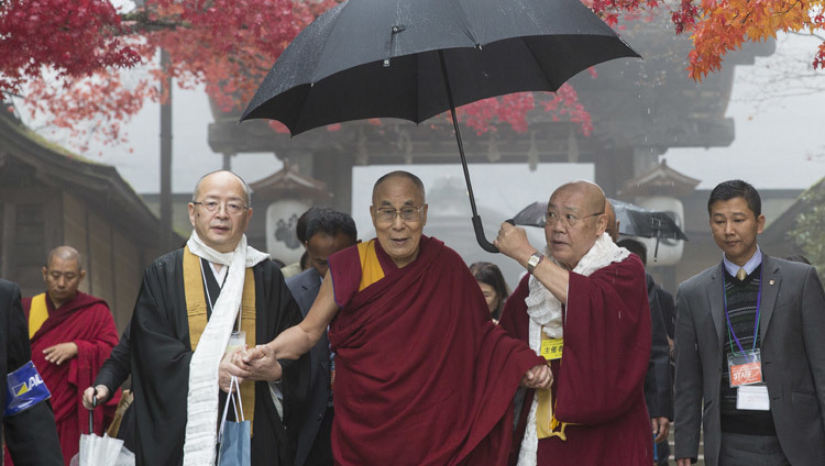 His Holiness the Dalai Lama walking to the hall in the morning mist for his talk in Koyasan, Japan on November 15, 2016. Photo/Jigme Choephel
