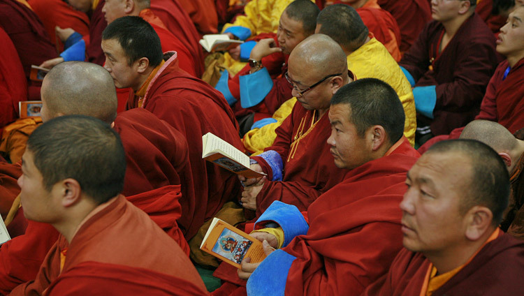 Members of the audience following the text during the afternoon session His Holiness the Dalai Lama's teaching in Ulaanbaatar, Mongolia on November 20, 2016. Photo/Igor Yanchoglov
