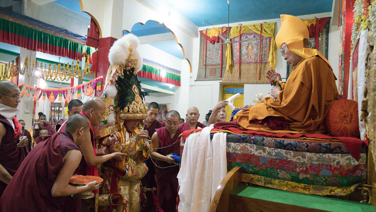 The Nechung Oracle approaching His Holiness the Dalai Lama during the Long Life ceremony at Drepung Lachi Assembly Hall in Mundgod, Karnataka, India on December 21, 2016. Photo/Tenzin Choejor/OHHDL