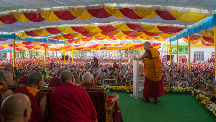 His Holiness the Dalai Lama speaking to the large crowd gathered in the courtyard of Drepung Lachi Assembly Hall to celebrate the 600h Anniversary of Drepung Monastery in Mundgod, Karnataka, India on December 21, 2016. Photo/Tenzin Choejor/OHHDL