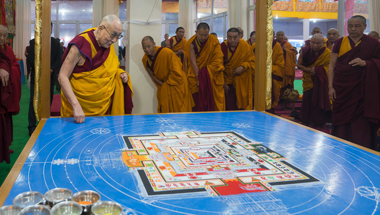 His Holiness the Dalai Lama inspecting the work on the sand mandala as after the morning's Kalachakra preparatory rituals in Bodhgaya, Bihar, India on January 6, 2017. Photo/Tenzin Choejor/OHHDL