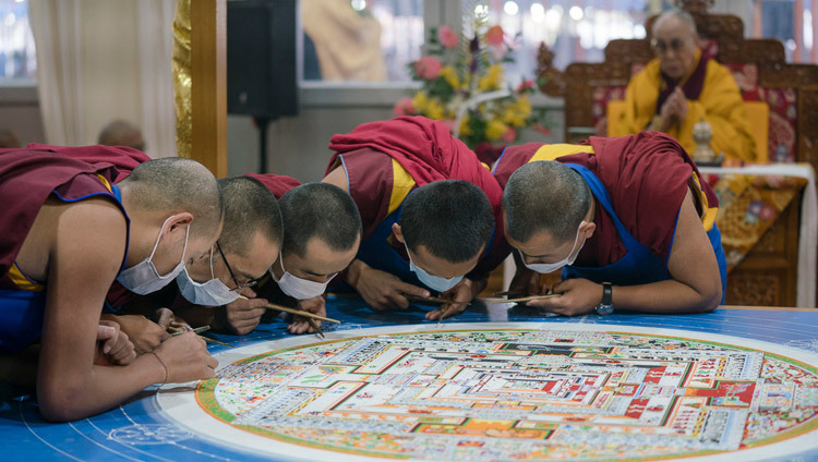 Monks from Namgyal Monastery working on the construction of the sand mandala during the preparation rituals for the Kalachakra Empowerment in Bodhgaya, Bihar, India on January 7, 2017. Photo/Tenzin Choejor/OHHDL