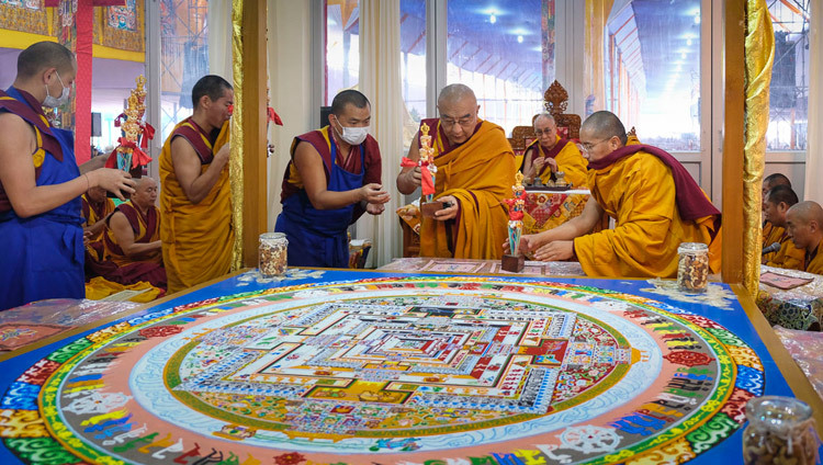 His Holiness the Dalai Lama looks on as Thamthog Rinpoche placing ritual implements around the completed Kalachakra sand mandala during preparations for the Kalachakra Empowerment in Bodhgaya, Bihar, India on January 8, 2017. Photo/Tenzin Choejor/OHHDL