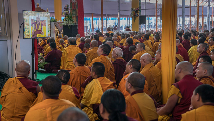 Members of the monastic community watching His Holiness the Dalai Lama on a TV during final day of teachings preliminary to the Kalachakra Empowerment in Bodhgaya, Bihar, India on January 8, 2017. Photo/Tenzin Choejor/OHHDL