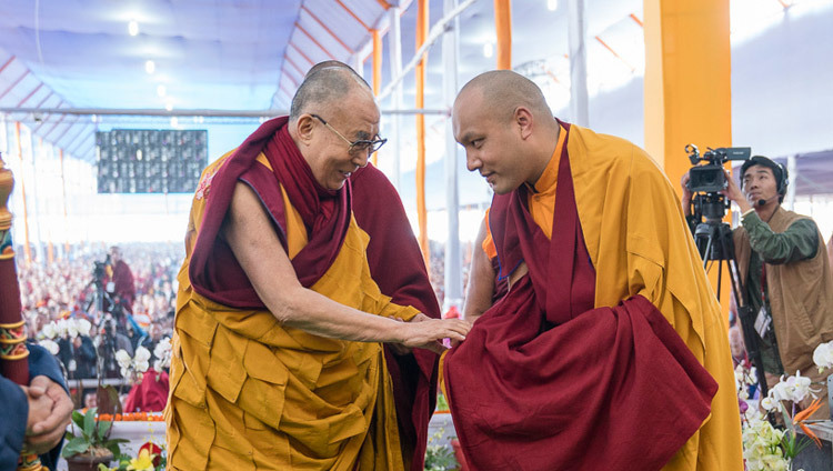 His Holiness the Dalai Lama exchanging greetings with Gyalwang Karmapa as he arrives on stage for the second day of the Kalachakra Empowerment, Seven Empowerments in the Pattern of Childhood, in Bodhgaya, Bihar, India on January 12, 2017. Photo/Tenzin Choejor/OHHDL