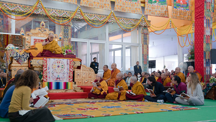 "A group of monks, nuns and lay-people reciting the ""Heart Sutra"" in Spanish at the start of the third and final day of the actual Kalachakra Empowerment in Bodhgaya, Bihar, India on January 13, 2017. Photo/Tenzin Choejor/OHHDL"