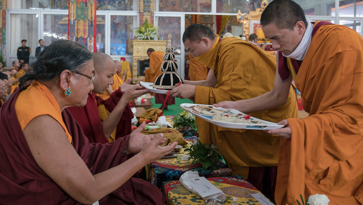 Monks from Namgyal Monastery presenting ritual objects to Sakya Trizin and Gyalwang Karmapa during the third and final day of the actual Kalachakra Empowerment in Bodhgaya, Bihar, India on January 13, 2017. Photo/Tenzin Choejor/OHHDL