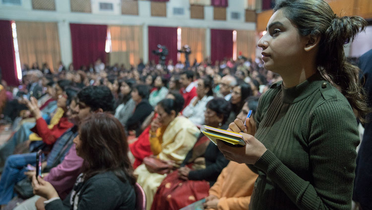 A student taking notes as His Holiness the Dalai Lama answers her question during his talk at Jesus & Mary College in New Delhi, India on February 7, 2017. Photo/Tenzin Choejor/OHHDL