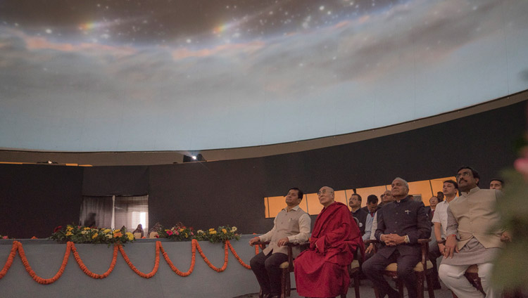 His Holiness the Dalai Lama and special guests watching a video display in a specially fashioned dome at the Namami Brahmaputra Festival in Guwahati, Assam, India on April 2, 2017. Photo by Tenzin Choejor/OHHDL