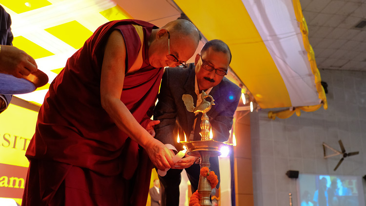 His Holiness the Dalai Lama and Registrar Prof M N Dutta lighting a lamp to inaugurate the program at Dibrugarh University in Dibrugarh, Assam, India on April 3, 2017. Photo by Ven Lobsang Kunga/OHHDL