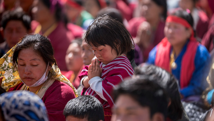 A young member of the crowd listening to His Holiness the Dalai Lama speaking on the second day of his teachings at the Yiga Choezin teaching ground in Tawang, Arunachal Pradesh, India on April 9, 2017. Photo by Tenzin Choejor/OHHDL