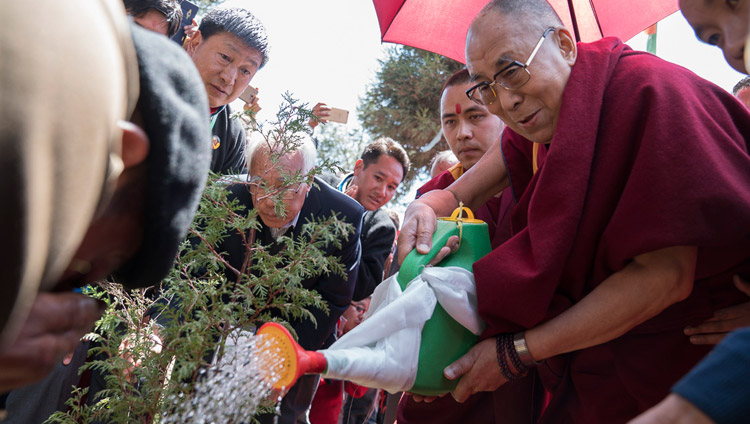 His Holiness the Dalai Lama planting a tree to inaugurate the project to plant 100,000 saplings at the conclusion of his teachings at the Yiga Choezin teaching ground in Tawang, Arunachal Pradesh, India on April 10, 2017. Photo by Tenzin Choejor/OHHDL