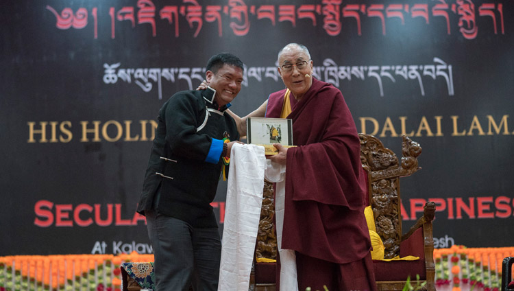 Arunachal Chief Minister Pema Khandu presenting His Holiness the Dalai Lama with a souvenir at the start of his talk at the Kalawangpo Convention Centre in Tawang, Arunachal Pradesh, India on April 10, 2017. Photo by Tenzin Choejor/OHHDL