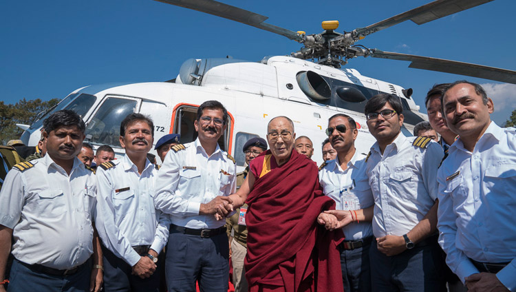 His Holiness the Dalai Lama with the helicopter flight crew before his departure for Guwahati from the helipad in Tawang, Arunachal Pradesh, India on April 11, 2017. Photo by Tenzin Choejor/OHHDL