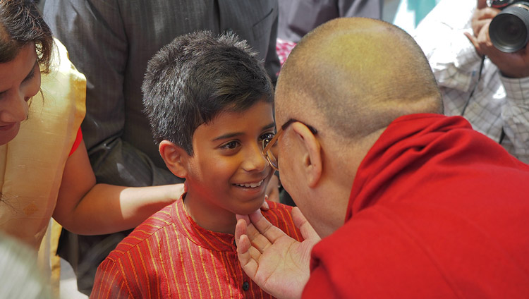 His Holiness the Dalai Lama greeting ML Sondhi's grandson Raghu on his arrival at the India International Centre to receive the Prof ML Sondhi Prize for International Politics in New Delhi, India on April 27, 2017. Photo by Jeremy Russell/OHHDL