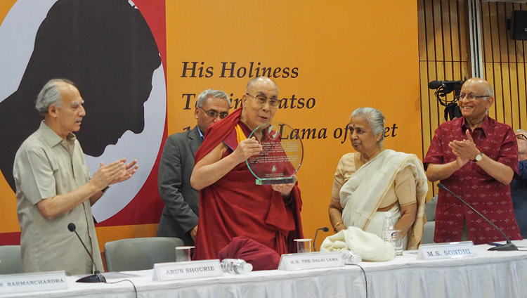 His Holiness the Dalai Lama holding a plaque denoting his receipt of the Professor ML Sondhi Prize for International Politics presented to him in New Delhi, India on April 27, 2017. Photo by Jeremy Russell/OHHDL