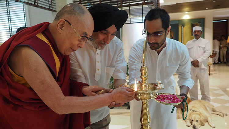 His Holiness the Dalai Lama along with Analjit Singh and his son Vir lighting a lamp to inaugurate the meeting with the Core Committee Working on the Curriculum for Universal Values in New Delhi, India on April 28, 2017. Photo by Jeremy Russell/OHHDL
