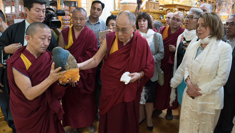 His Holiness the Dalai Lama showing members of the bipartisan US Congressional Delegation part of a statue destroyed by the Chinese as he guides them on a tour of the Main Tibetan Temple Dharamsala, HP, India on May 10, 2017. Photo by Tenzin Choejor/OHHDL