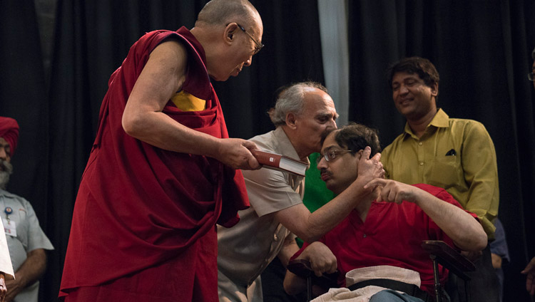 "Arun Shourie embracing his son Aditya who had handed His Holiness the Dalai Lama a copy of ""Two Saints"" to mark the launch of the book at the Indian International Centre in New Delhi, India on May 25, 2017. Photo by Tenzin Choejor/OHHDL"