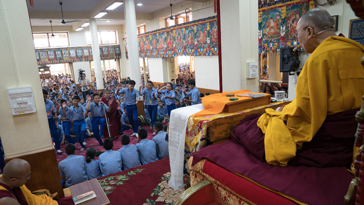 His Holiness the Dalai Lama looks on as young students engage in Buddhist philosophical debate during the second day of his teaching for Tibetan youth at the Main Tibetan Temple in Dharamsala, HP, India on June 6, 2017. Photo by Tenzin Choejor/OHHDL