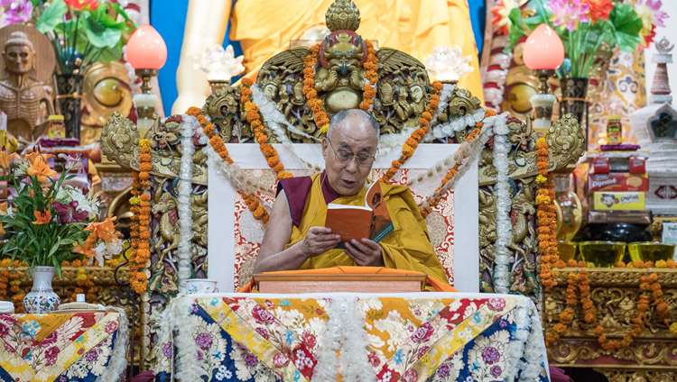 His Holiness the Dalai Lama reading from the text during the final day of his three day teaching for Tibetan youth at the Main Tibetan Temple in Dharamsala, HP, India on June 7, 2017. Photo by Tenzin Choejor/OHHDL
