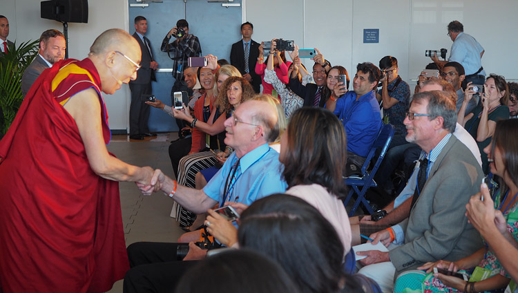 His Holiness the Dalai Lama greeting members of the media as he arrives for their meeting in San Diego, CA, USA on June 16, 2017. Photo by Jeremy Russell/OHHDL