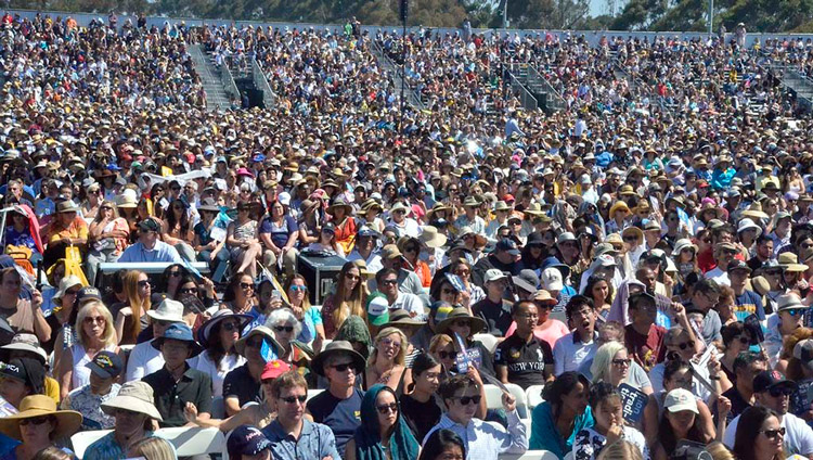 Some of the more that 25,000 people attending His Holiness the Dalai Lama's talk at UC San Diego's RIMAC Field in San Diego, CA, USA on June 16, 2017. Photo by Chris Stone