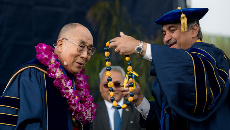 Chancellor Pradeep Khosla presenting His Holiness the Dalai Lama with a garland and string of beads after awarding the USCD medal at the UCSD Commencement ceremony in San Diego, CA, on June 17, 2017. Photo by Erik Jepsen/UC San Diego