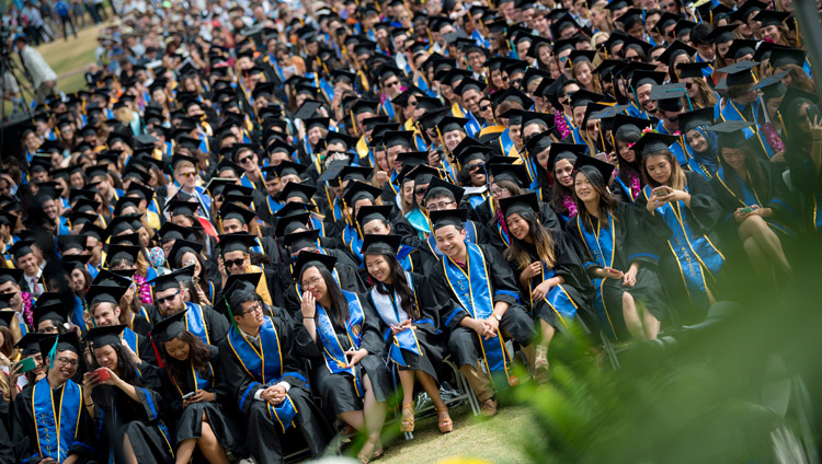 Graduates attending the UCSD Commencement ceremony listening to His Holiness the Dalai Lama delivering the Keynote Address at RIMAC Field in San Diego, CA, on June 17, 2017. Photo by Erik Jepsen/UC San Diego