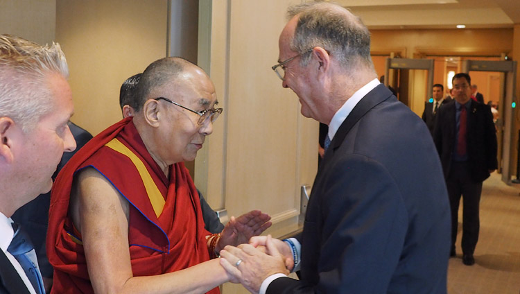 His Holiness the Dalai Lama greeting Anaheim Mayor Tom Tait as he prepares to meet with school principals and teachers in Newport Beach, CA, USA on June 20, 2017. Photo by Jeremy Russell/OHHDL