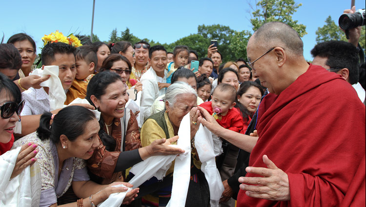 His Holiness the Dalai Lama greeting some of the over 400 Tibetans gathered to welcome him on his arrival in Minneapolis, MN, USA on June 21, 2017. Photo by Tenzin Phuntsok Waleag