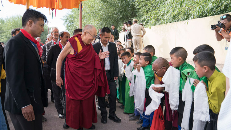His Holiness the Dalai Lama greeting young students on his way to the Shiwatsel teaching ground in Leh, Ladakh, J&K, India on July 6, 2017. Photo by Tenzin Choejor/OHHDL