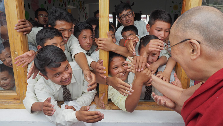 Students reaching out to His Holiness the Dalai Lama as he departs from Ladakh Public School in Leh, Ladakh, J&K, India on July 8, 2017. Photo by Jeremy Russell/OHHDL