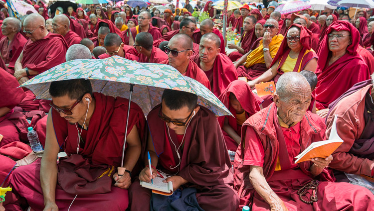 Members of the monastic community following the text during the first day of His Holiness the Dalai Lama's teachings in Disket, Nubra Valley, J&K, India on July 11, 2017. Photo by Tenzin Choejor/OHHDL
