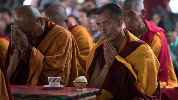 Monks watching as His Holiness the Dalai Lama conducts preliminary rituals on the final day of his teachings in Disket, Nubra Valley, J&K, India on July 13, 2017. Photo by Tenzin Choejor/OHHDL