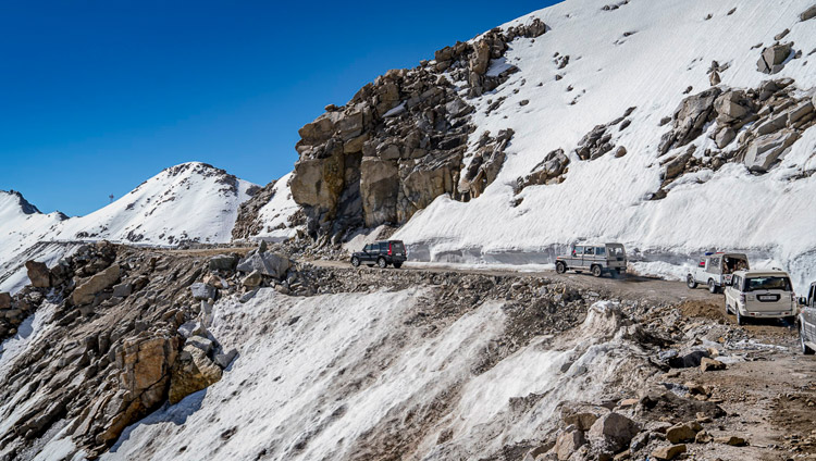 His Holiness the Dalai Lama's motorcade nearing the top of Khardungla Pass in Ladakh, J&K, India on July 15, 2017, which at 18,380 feet / 5,359 meters is the highest motorable pass in the world. Photo by Tenzin Choejor/OHHDL