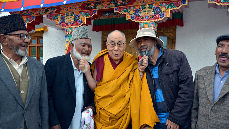 His Holiness the Dalai Lama playfully posing with Muslim representatives during his visit Anjuman Moen-Ul-Islam school in Padam, Zanskar, J&K, India on July 18, 2017. Photo by Lobsang Tsering/OHHDL