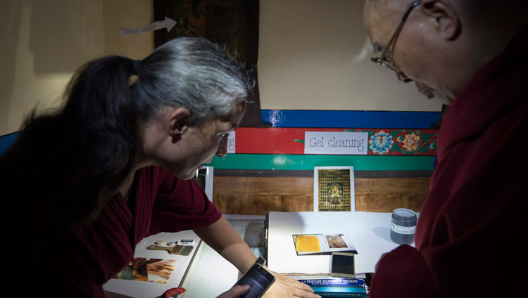 A member of a restoration team explaining to His Holiness the Dalai Lama some of the methods used to restore old Tibetan thangkas during his visit to Matho Monastery in Leh, Ladakh, J&K, India on July 20, 2017. Photo by Tenzin Choejor/OHHDL