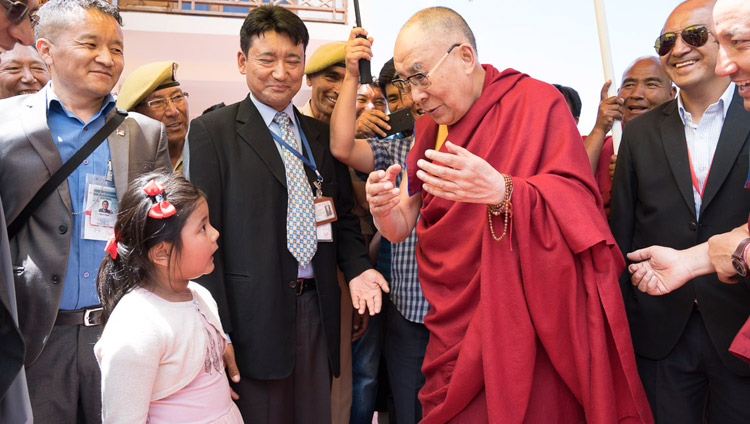 His Holiness the Dalai Lama is charmed by a young girl asking serious questions as he departs from Matho Phodrang in Leh, Ladakh, J&K, India on July 20, 2017. Photo by Tenzin Choejor/OHHDL