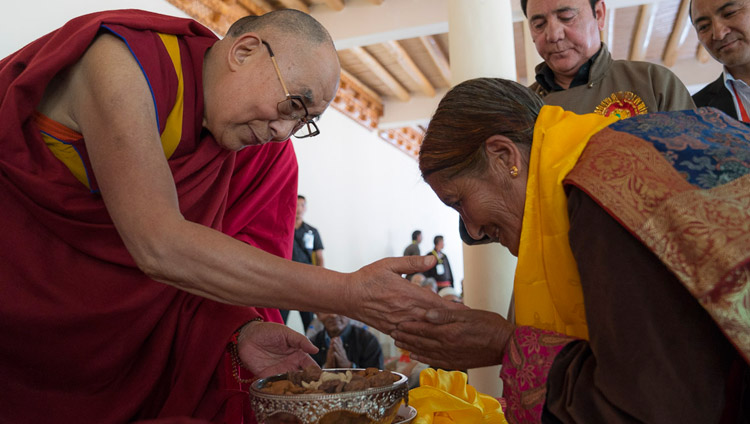 His Holiness the Dalai Lam presenting a gift to a Buddhist supporter of the Muslim community during his visit to Id-Gah in Leh, Ladakh, J&K, India on July 26, 2017. Photo by Tenzin Choejor/OHHDL