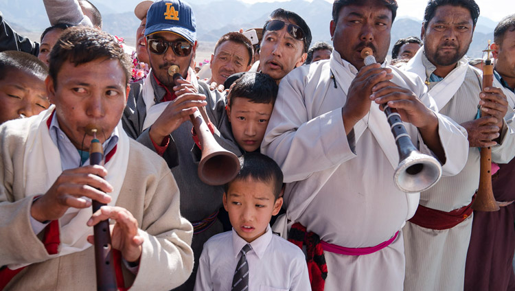 Local residents playing traditional instruments welcoming His Holiness the Dalai Lama as he arrives at Dudjom Nunnery in Shey, Ladakh, J&K, India on July 26, 2017. Photo by Tenzin Choejor/OHHDL