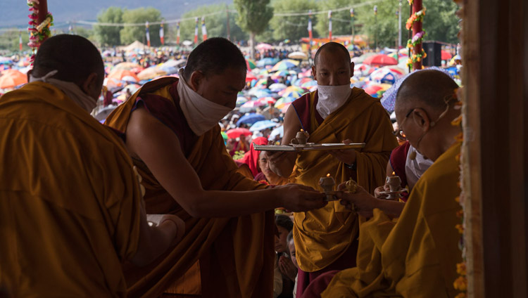 Assistants handing His Holiness the Dalai Lama ritual offerings during the Long-Life Empowerment in Leh, Ladakh, J&K, India on July 30, 2017. Photo by Tenzin Choejor/OHHDL