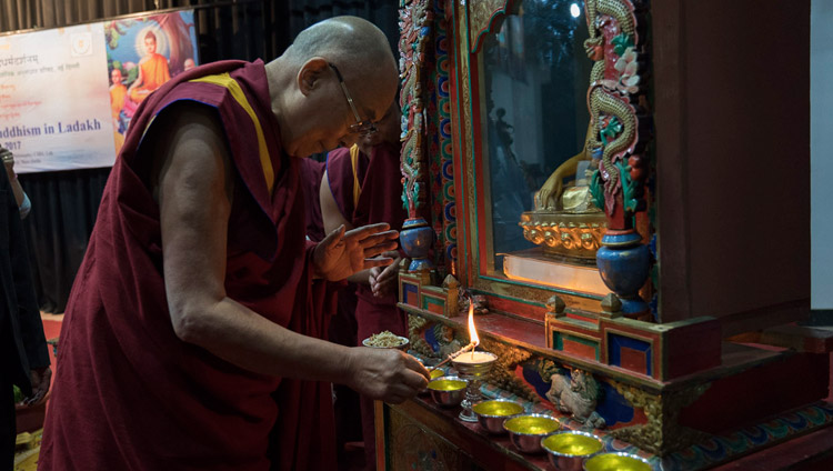 His Holiness the Dalai Lama lighting a lamp to formally open a three day seminar on 'Buddhism in Ladakh' at the Central Institute of Buddhist Studies in Leh, Ladakh, J&K, India on August 1, 2017. Photo by Tenzin Choejor/OHHDL